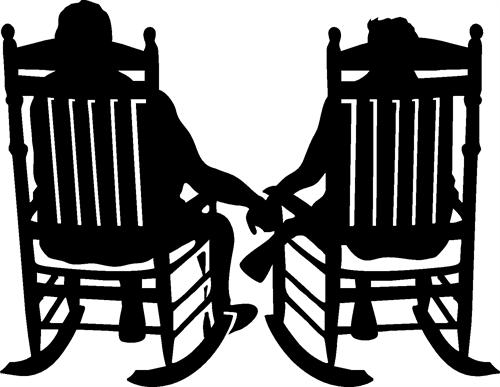 couple holding hands in chairs